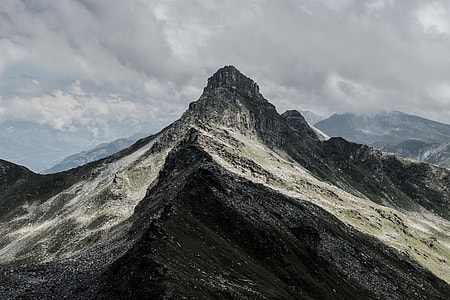 black and white mountain under gray cloudy sky