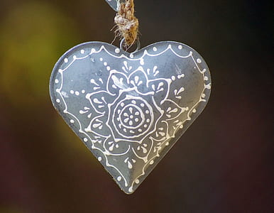 gray and white floral heart pendant