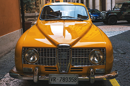 Classic old yellow Saab car