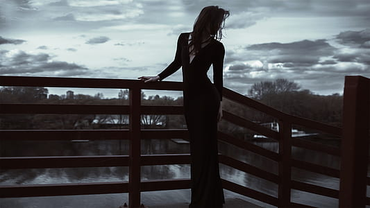 woman in black long-sleeved long dress