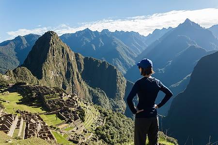 girl standing on Mossu Piccu, Peru under blue sky