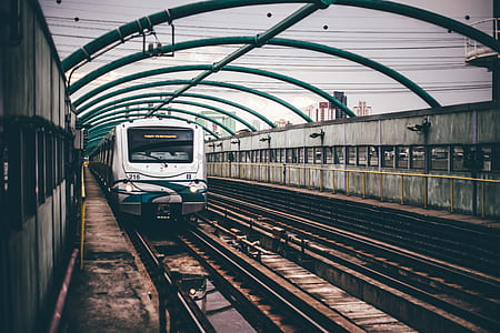 Gray and Green Train on Railings during Daytime