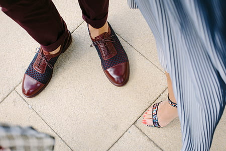 person wearing red leather oxford hsoes