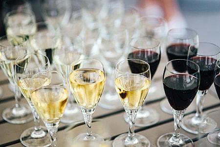 Glasses with wine and orange juice