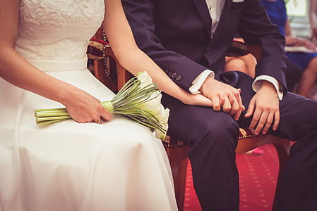 bride and groom sitting on chair
