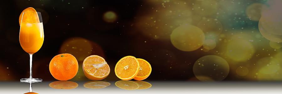 wine glass near sliced orange fruits