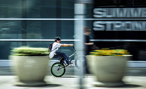 Man Riding Bicycle in City