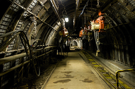 photo of tunnel with orange electric hoist hanging on the ceiling