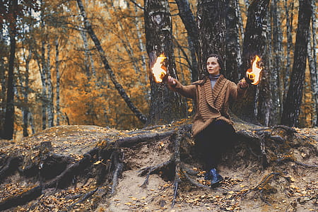 girl playing with fire in forest