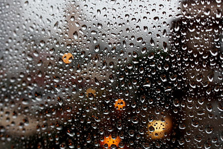 Full Frame Shot of Raindrops on Glass Window