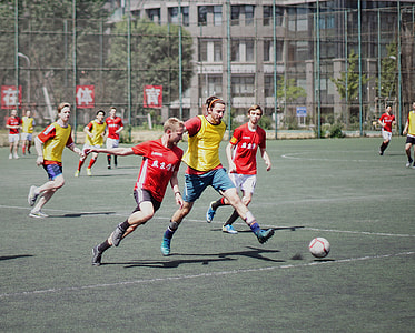 players playing soccer during daytime
