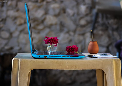 Blue Laptop Computer On Brown Plastic Table