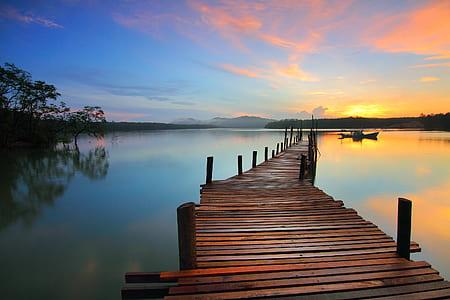 brown wooden sea dock during golden hour