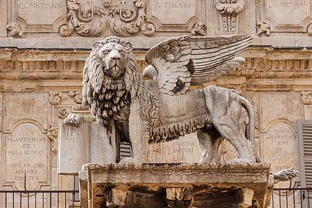 white concrete lion concrete statue