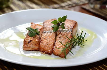 photo of cooked fish on plate