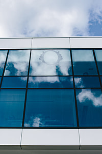 Office building windows and blue sky