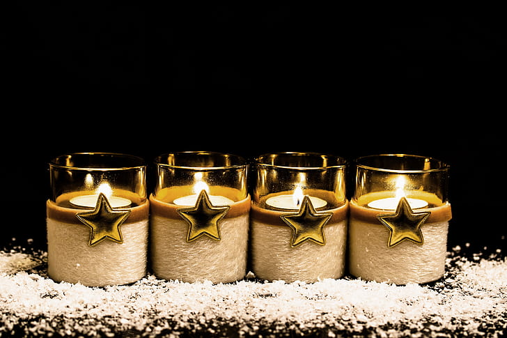 four glass candle holders photo
