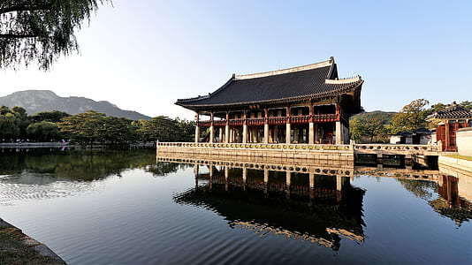 temple with body of water