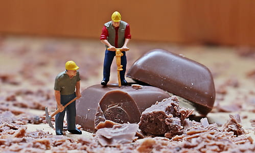 two construction men hammering chocolate bar mini figures