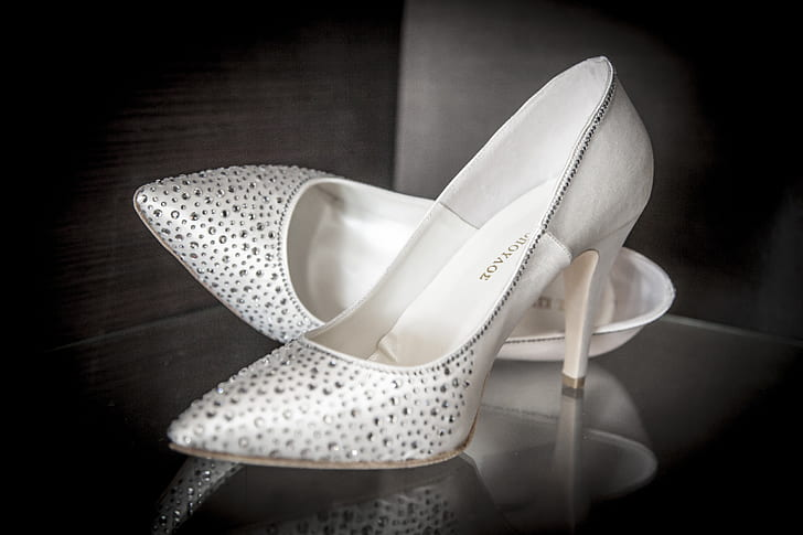 pair of white beaded leather pointed-toe pumps