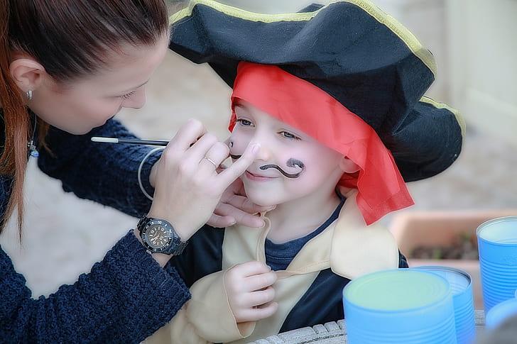 kid wearing pirate costume