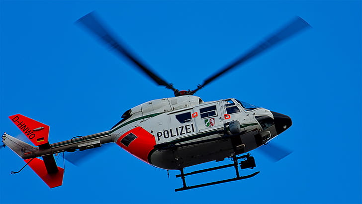 white and red Polizei helicopter