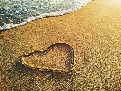 brown heart sand near sea shore
