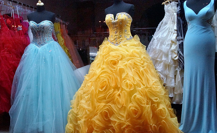 Royalty-Free photo: Women's assorted-colored gowns on display during daytime | PickPik