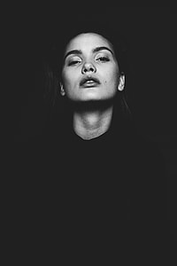 woman wearing black sweater with black background photo