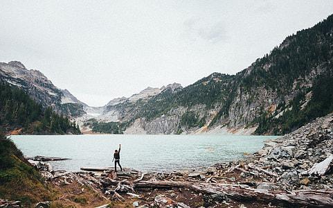 man standing near water body during daytime