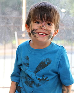 photo of boy with face paint