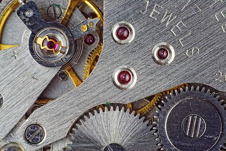 gray steel clock gear