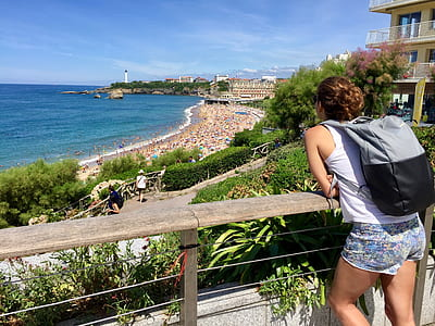 Woman In White Tank Top Leaning On Railing
