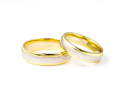 two silver-and-gold-colored bridal rings