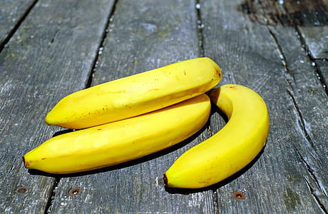 three yellow ripe bananas