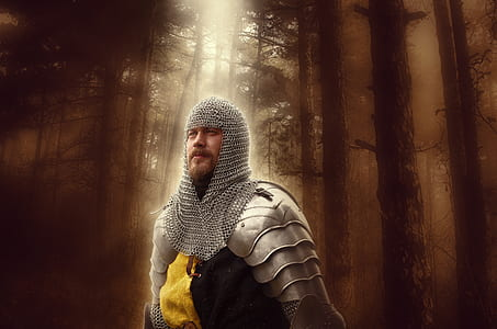 armored man on forest with sun ray digital wallpaper