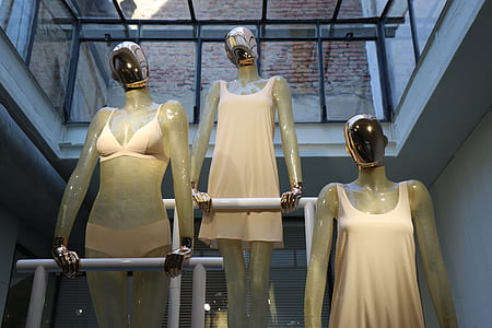 three woman mannequins on pole