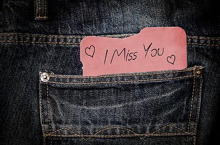 card with i miss you print on denim pocket