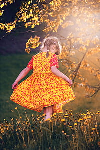 toddler girl in yellow floral dress