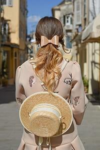 woman in beige long-sleeved dress