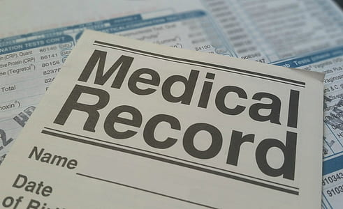 Medical Record form on blue and white paper