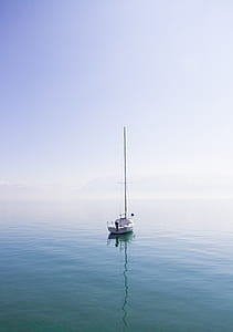 photo of white boat on body of water