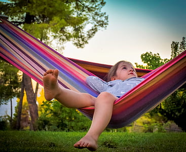 girl on hammock above turf