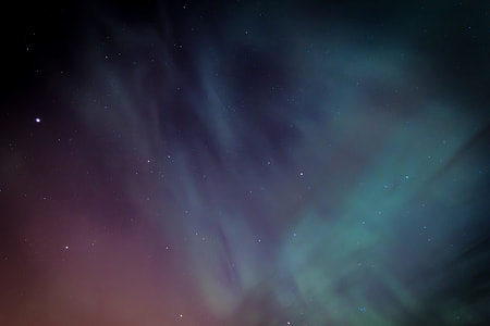 Stars and Northern Lights in the night sky