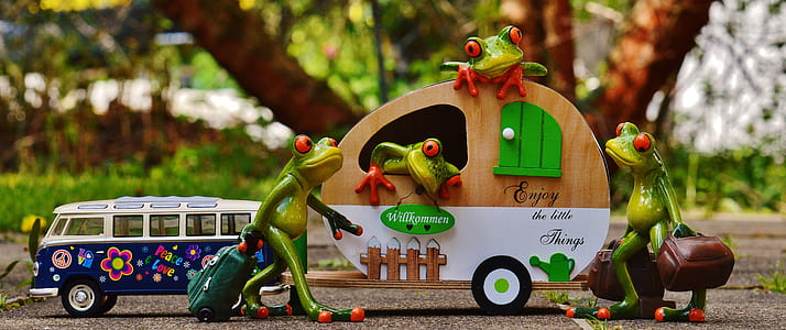 green ceramic frog figurines and brown trailer miniature