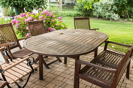 outdoor oval wooden table and chairs