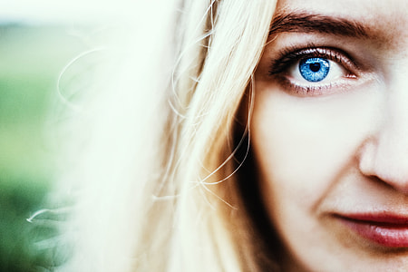 selective photograph of woman with blue eyes