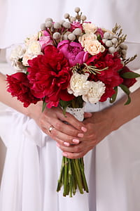 red carnation flowers and white rose flowers wedding bouquet