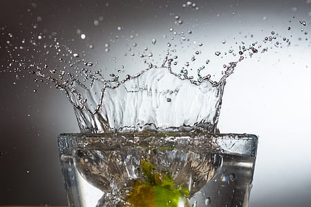 splash of water on drinking glass