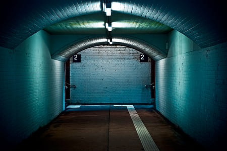 hallway with teal colored walls
